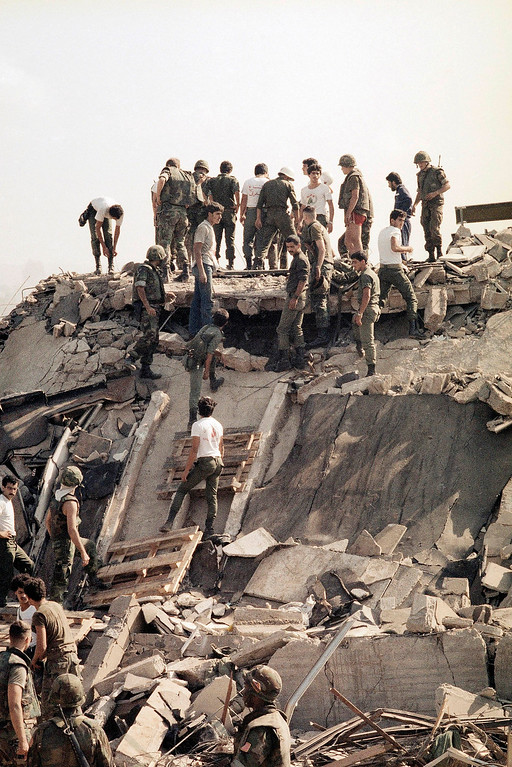 . This Oct. 23, 23, 1983 file photo shows the scene around the U.S. Marine barracks near Beirut airport following a massive bomb blast that destroyed the base, in Beirut, Lebanon. The blast _ the single deadliest attack on U.S. forces abroad since World War II _ claimed the lives of 241 American service members.(AP Photo, File)