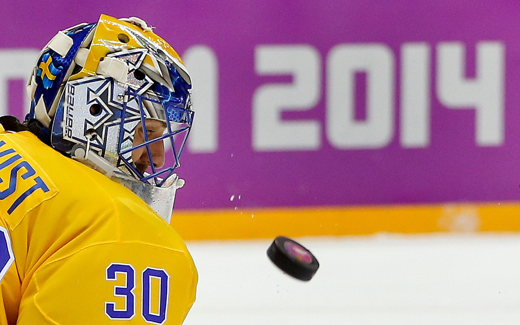 . Sweden goaltender Henrik Lundqvist blocks a shot by Finland during the third period of a men\'s semifinal ice hockey game at the 2014 Winter Olympics, Friday, Feb. 21, 2014, in Sochi, Russia. (AP Photo/Julio Cortez)