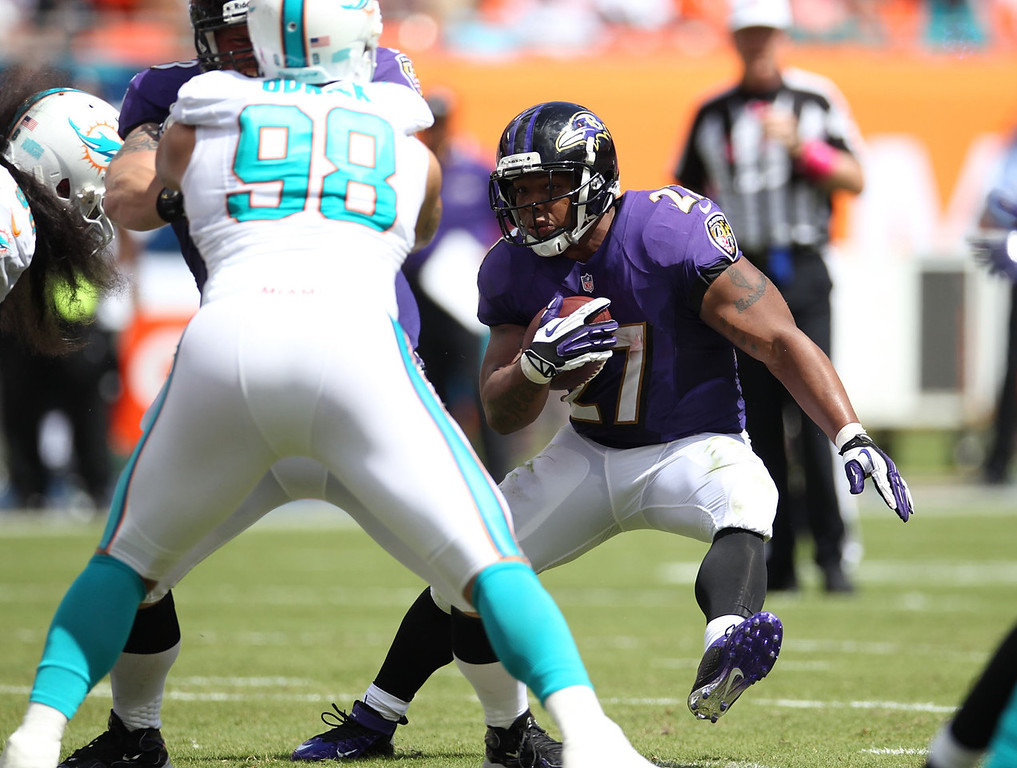 . Running back Ray Rice #27 of the Baltimore Ravens runs against the Miami Dolphins at Sun Life Stadium on October 6, 2013 in Miami Gardens, Florida.  (Photo by Marc Serota/Getty Images)