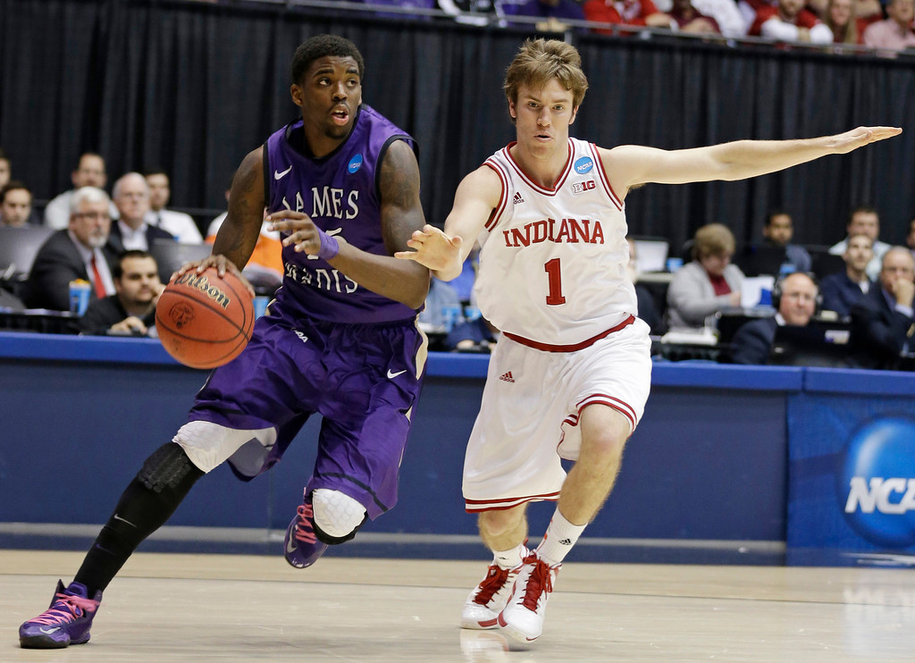 . James Madison guard Andre Nation, left, drives around Indiana guard Jordan Hulls (1) in the second half of a second-round game at the NCAA college basketball tournament on Friday, March 22, 2013, in Dayton, Ohio. (AP Photo/Al Behrman)