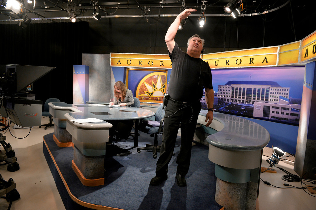 . AURORA, CO. - FEBRUARY 18: Floor Director Ray Stallkamp checks the lighting on the set before taping Aurora News Weekly in Aurora, CO February 18, 2014. The 30 minute news show is part of Aurora 8\'s public access programming. Stallkamp works at the station as a volunteer and is also the city\'s Veterans Affairs Chair Commissioner, also a volunteer position. (Photo By Craig F. Walker / The Denver Post)