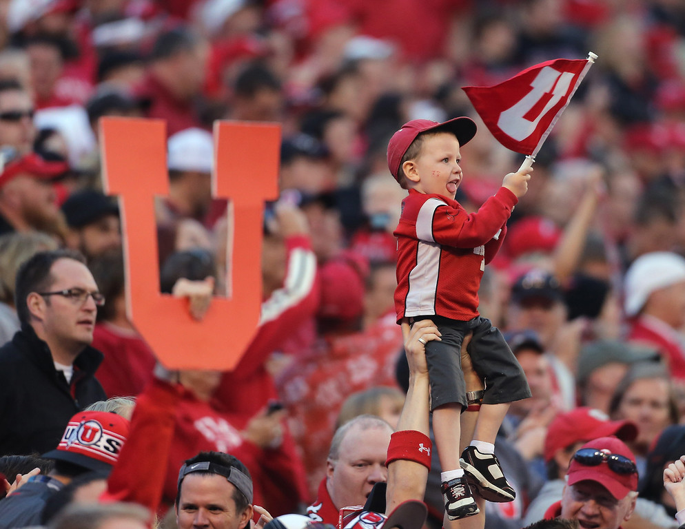 . SALT LAKE CITY, UT - OCTOBER 12: Fans of the Utah Utes cheer during a game against the Stanford Cardinal during the first half of an NCAA football game October 12, 2013 at Rice Eccles Stadium in Salt Lake City, Utah. Utah Beat Stanford 27-21. (Photo by George Frey/Getty Images)