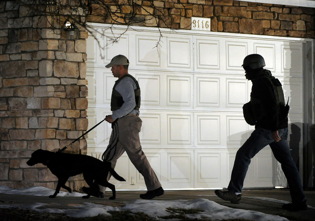 . HIGHLANDS RANCH, CO. - DECEMBER 13: An Alcohol, Tobacco and Firearms officer brought a dog into a home in Highlands Ranch that is connected to the Arapahoe High School shooting Friday night, December 13, 2013.  The house at 9116 S. Sugarstone Circle is where authorities believe Karl Pierson lived with his mother. (Photo By Karl Gehring/The Denver Post)