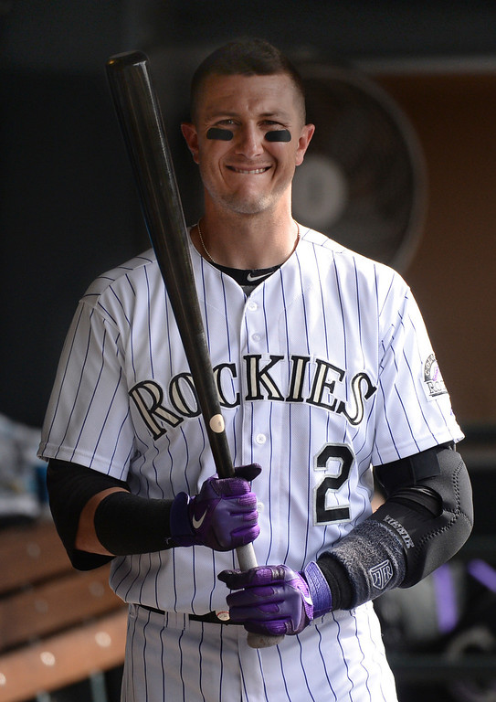 . DENVER, CO - JUNE 20: Troy Tulowitzki walked through the dugout following the loss. The Milwaukee Brewers defeated the Colorado Rockies 9-4 at Coors Field Saturday afternoon, June 21, 2014. Photo by Karl Gehring/The Denver Post