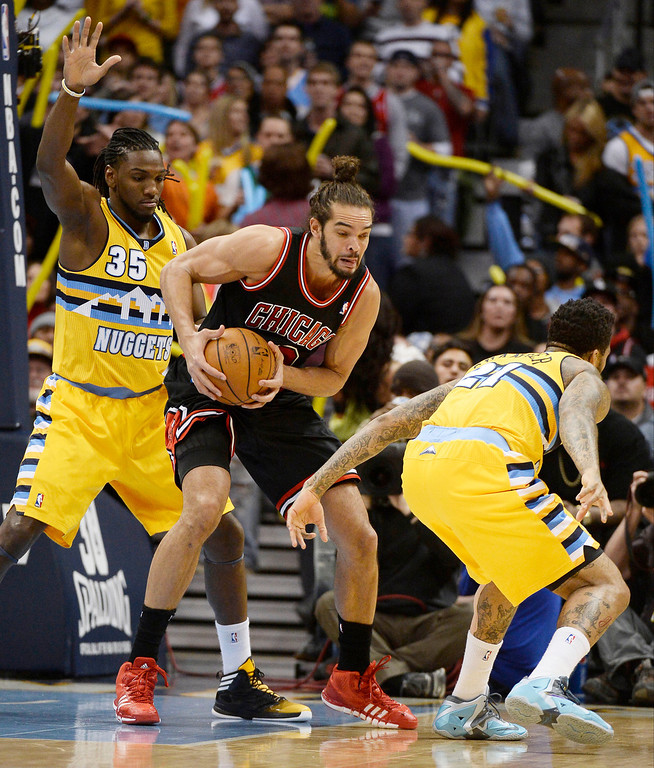 . Chicago Bulls center Joakim Noah (13) pulls the ball away from Denver Nuggets small forward Wilson Chandler (21) as Denver Nuggets power forward Kenneth Faried (35) plays defense during the first quarter November 21, 2013 at Pepsi Center. (Photo by John Leyba/The Denver Post)