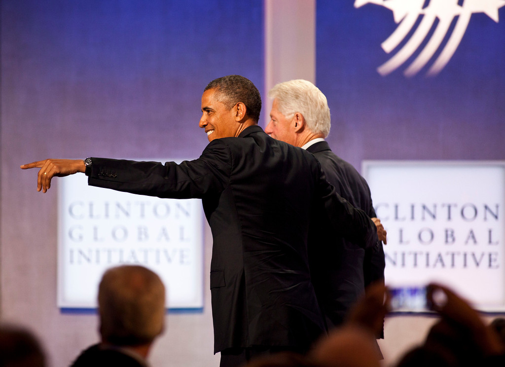 . NEW YORK - SEPTEMBER 24: U.S. President Barack Obama (L) and former U.S. President Bill Clinton leave the stage during the annual Clinton Global Initiative (CGI) meeting on September 24, 2013 in New York City. Timed to coincide with the United Nations General Assembly, CGI brings together heads of state, CEOs, philanthropists and others to help find solutions to the world\'s major problems.  (Photo by Ramin Talaie/Getty Images)