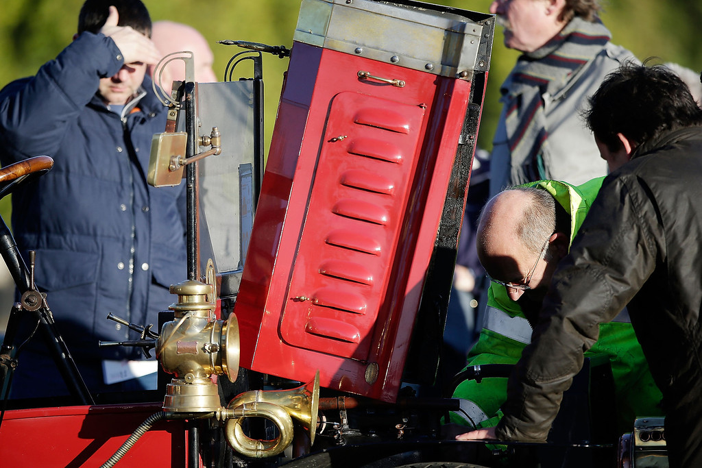 . A broken down participant in the Royal Automobile Club\'s annual Veteran Car Run receives break down asssistance on Westminster Bridge on November 3, 2013 in London, England. Around 500 eligible pre-1905 cars take part in The Royal Automobile Club\'s annual 60-mile drive from Hyde Park in central London to the seafront on the Sussex resort of Brighton. It is the longest running motoring event in the world, and attracts entrants from across the globe.  (Photo by Matthew Lloyd/Getty Images)