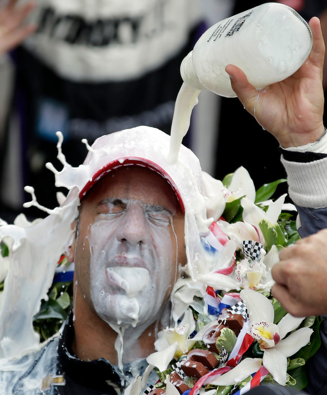 . Tony Kanaan, of Brazil, celebrates with winners milk after winning the Indianapolis 500 auto race at the Indianapolis Motor Speedway in Indianapolis, Sunday, May 26, 2013. (AP Photo/Michael Conroy, File)