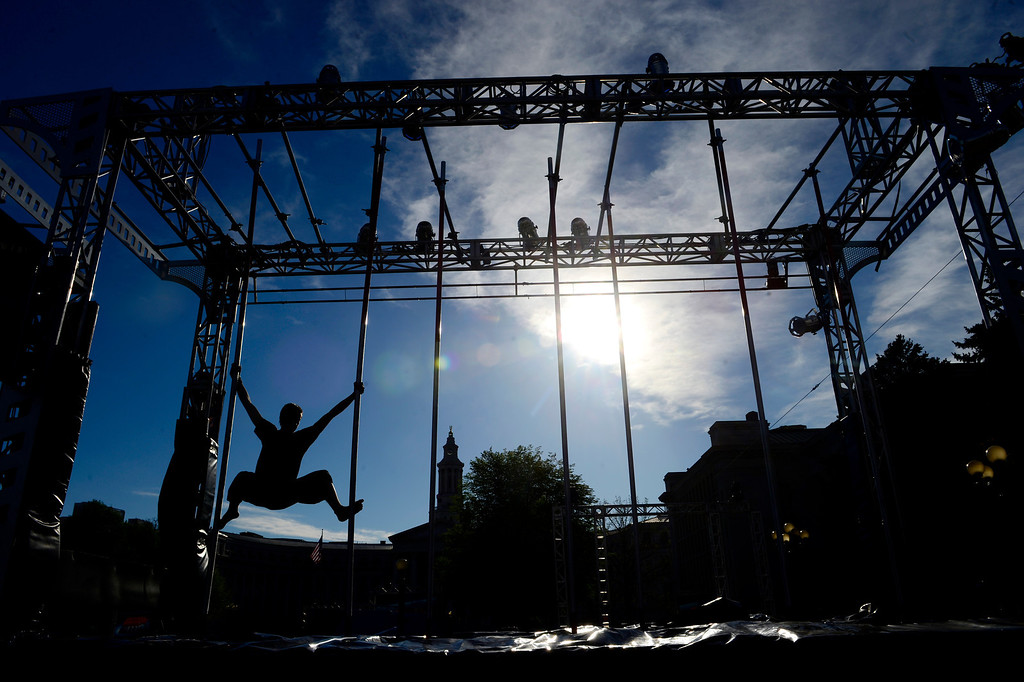 . Course tester Oliver Ehrhardt works the course before the tryout for American Ninja Warrior Denver on on May 19, 2013. (Photo by AAron Ontiveroz/The Denver Post)