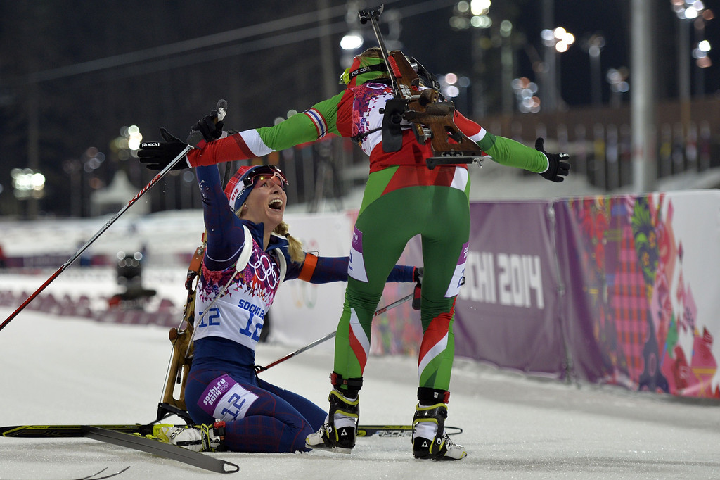 . Bronze medalist Norway\'s Tiril Eckhoff (12) is congratulated by gold medalist Belarus\' Darya Domracheva in the Women\'s Biathlon 12,5 km Mass Start at the Laura Cross-Country Ski and Biathlon Center during the Sochi Winter Olympics on February 17, 2014, in Rosa Kuthor, near Sochi.  AFP PHOTO / ODD  ANDERSEN/AFP/Getty Images