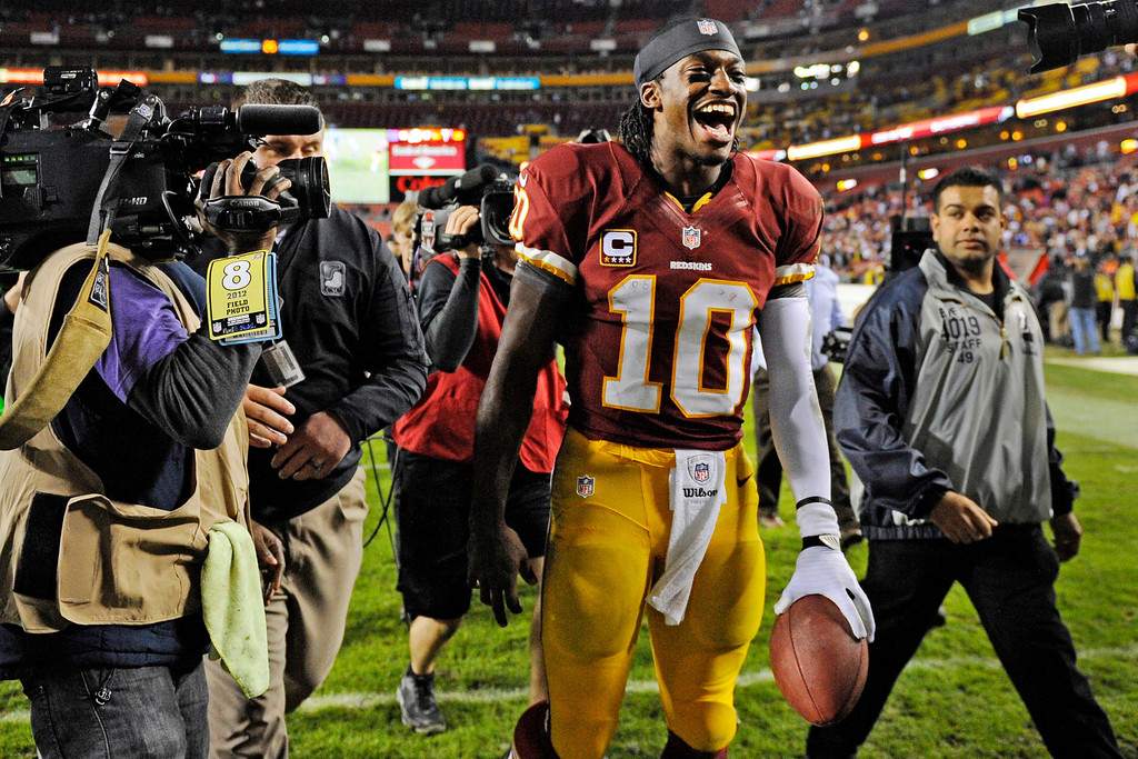. Washington Redskins quarterback Robert Griffin III celebrates as he leaves the field after an NFL football game against the New York Giants in Landover, Md., Monday, Dec. 3, 2012. The Redskins won 17-16. (AP Photo/Nick Wass)