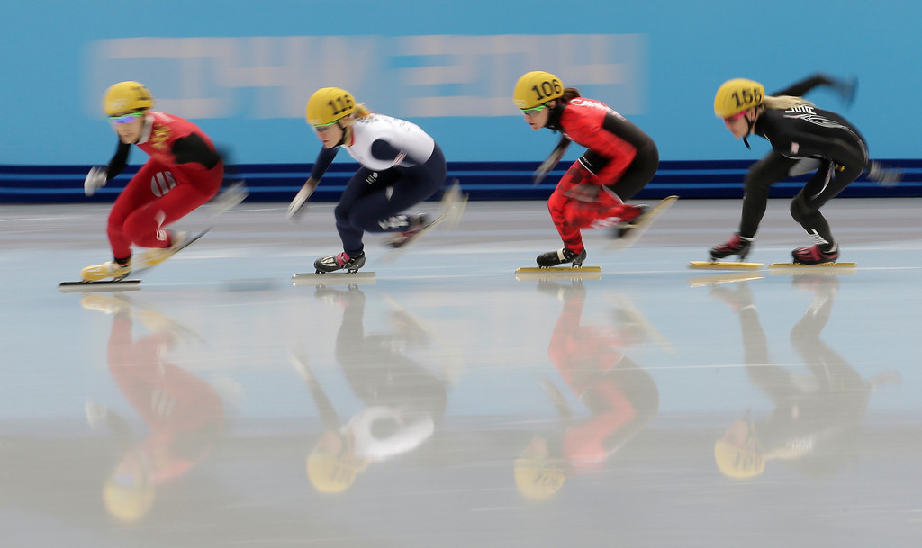 . Fan Kexin of China, Elise Christie of Britain, Jessica Hewitt of Canada and Emily Scott of the United States compete in a women\'s 500m short track speedskating quarterfinal at the Iceberg Skating Palace during the 2014 Winter Olympics, Thursday, Feb. 13, 2014, in Sochi, Russia. (AP Photo/Bernat Armangue)