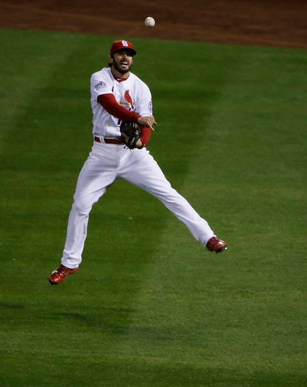 . St. Louis Cardinals second baseman Matt Carpenter makes the throw to third on a single by Boston Red Sox David Ortiz during the eighth inning of Game 5 of baseball\'s World Series Monday, Oct. 28, 2013, in St. Louis. (AP Photo/Charlie Neibergall)