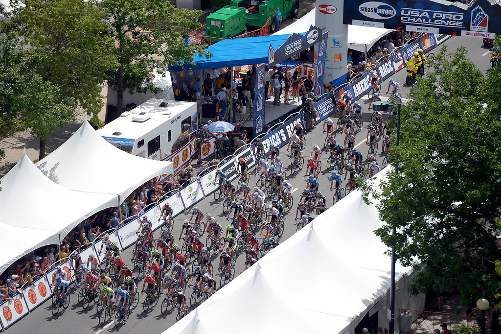 . Riders head out for the start of the final stage in the USA Pro Cycle Challenge as it makes it way through downtown Denver August 25, 2013. Aspen\'s Tejay van Garderen won the 3rd annual Pro Cycle Challenge. (Photo by John Leyba/The Denver Post)