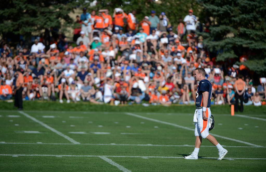. ENGLEWOOD, CO - JULY 27: Denver Broncos QB, Peyton Manning takes the field at the start of training camp at Dove Valley Saturday July 26, 2013.  (Photo By Andy Cross/The Denver Post)