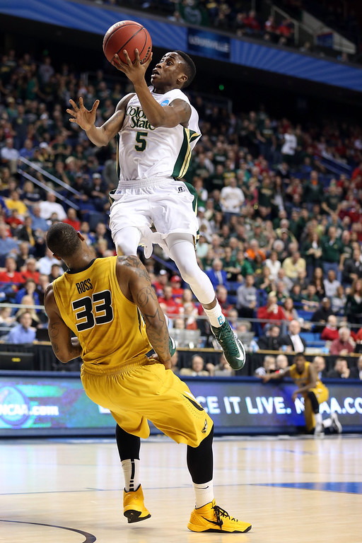 . LEXINGTON, KY - MARCH 21:  Jon Octeus #5 of the Colorado State Rams goes to the hoops against Earnest Ross #33 of the Missouri Tigers during the second round of the 2013 NCAA Men\'s Basketball Tournament at the Rupp Arena on March 21, 2013 in Lexington, Kentucky.  (Photo by Andy Lyons/Getty Images)
