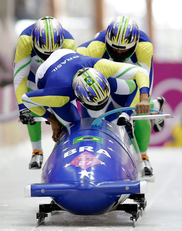 . The team from Brazil BRA-1, with Edson Bindilatti, Odirlei Pessoni, Edson Ricardo Martins and Fabio Goncalves Silva, struggles at the start of their third run during the men\'s four-man bobsled competition final at the 2014 Winter Olympics, Sunday, Feb. 23, 2014, in Krasnaya Polyana, Russia. (AP Photo/Natacha Pisarenko)
