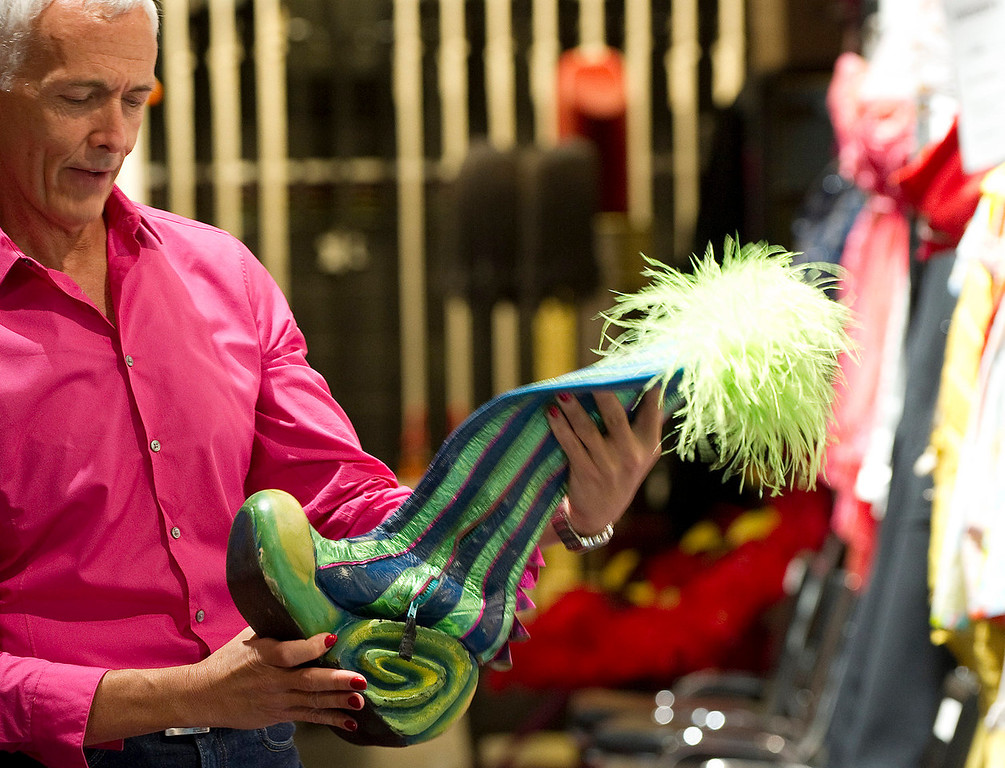 """. Actor Scott Willis, who plays \""""Bernadette\"""" holds an exotic boot that he wears in the show backstage at the Buell Theatre for the colorful production of \""""Priscilla Queen of the Desert The Musical\"""" on Thursday September 5, 2013. There are over 500 Tony Award winning costumes.   (Photo By Cyrus McCrimmon/The Denver Post )"""