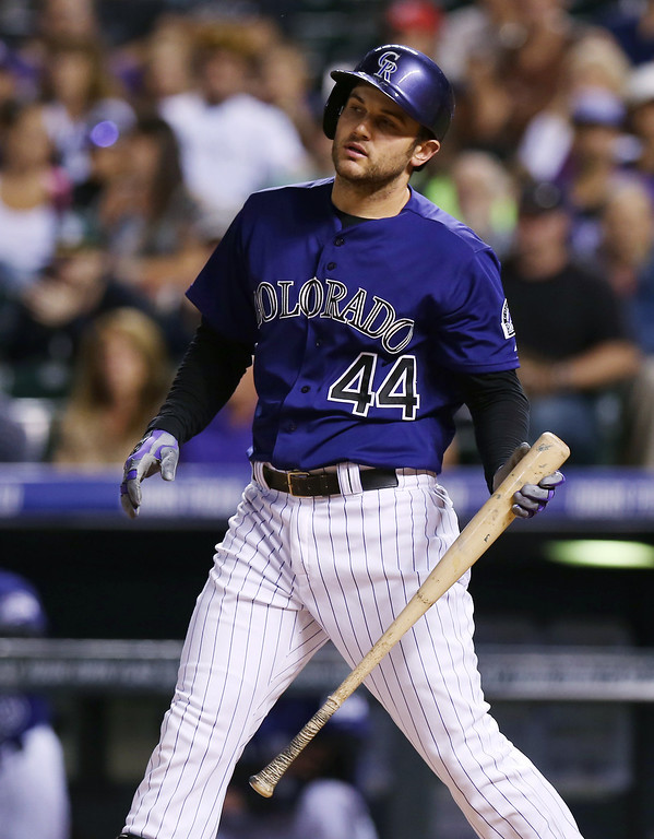 . Colorado Rockies pinch-hitter Ryan Wheeler reacts after striking out against the St. Louis Cardinals to end the eighth inning of the Cardinals\' 8-0 victory in a baseball game in Denver on Monday, June 23, 2014. (AP Photo/David Zalubowski)
