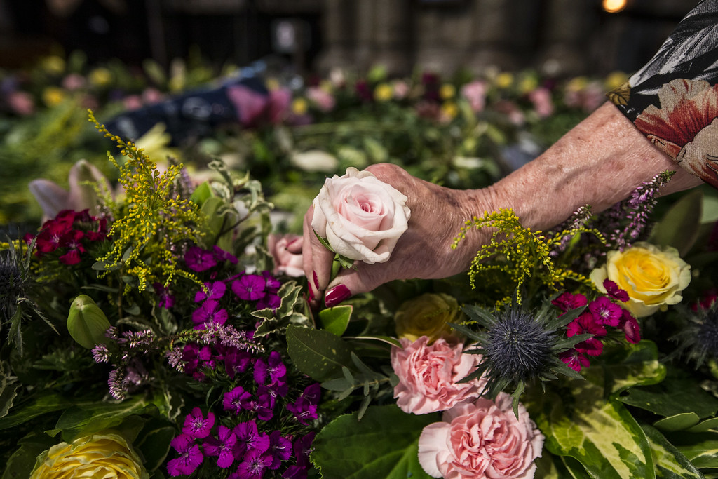 . LONDON, ENGLAND - AUGUST 03:  Flowers are prepared to dress the \'Grave of the Unknown Warrior\' ahead of a candlelight vigil on August 4 marking the start of WW1, at Westminster Abbey on August 3, 2014 in London, England. Members of the National Association of Flower Arranging Societies dress the grave in flowers from the four nations including lilies, heather and roses. Monday 4th August marks the 100th anniversary of Great Britain declaring war on Germany. In 1914 British Prime Minister Herbert Asquith announced at 11pm that Britain was to enter the war after Germany had violated Belgium neutrality. The First World War or the Great War lasted until 11 November 1918 and is recognised as one of the deadliest historical conflicts with millions of causalities. A series of events commemorating the 100th anniversary are taking place throughout the day.  (Photo by Dan Kitwood/Getty Images)