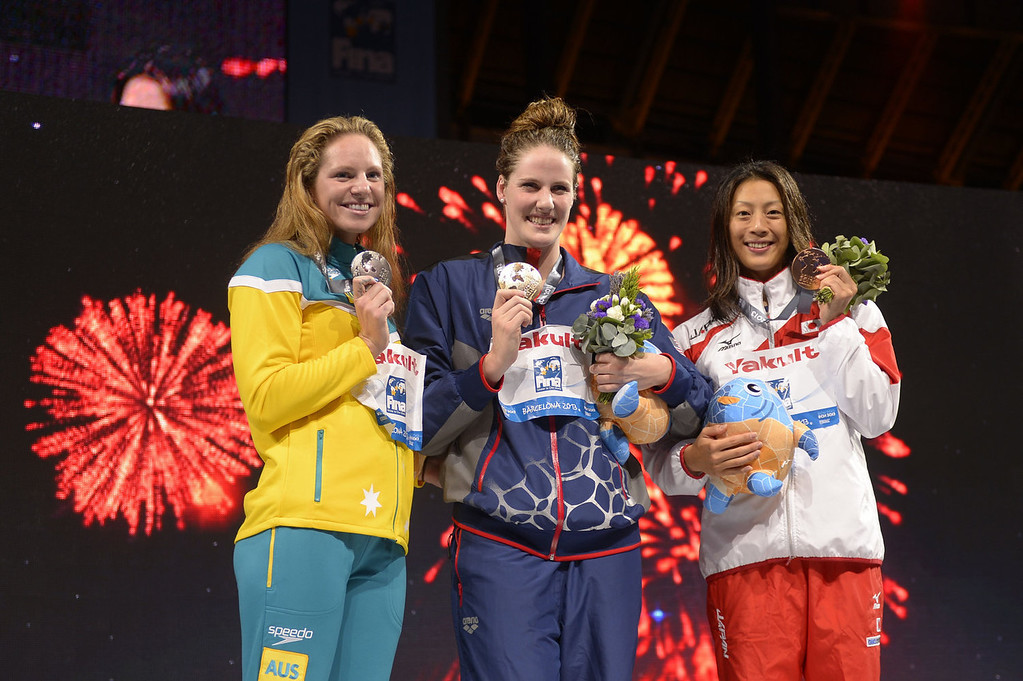 . Gold medalist US swimmer Missy Franklin (C), silver medalist Australia\'s Emily Seebohm (L) and bronze medalist Japan\'s Aya Terakawa pose on the podium during the award ceremony of the women\'s 100-metre backstroke swimming event in the FINA World Championships at Palau Sant Jordi in Barcelona on July 30, 2013.  FABRICE COFFRINI/AFP/Getty Images