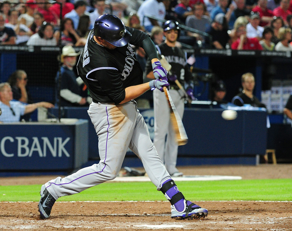 . ATLANTA, GA - MAY 23: Michael Cuddyer #3 of the Colorado Rockies hits a 6th inning solo home run against the Atlanta Braves at Turner Field on May 23, 2014 in Atlanta, Georgia. (Photo by Scott Cunningham/Getty Images)