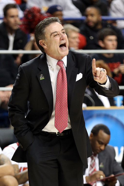 . LEXINGTON, KY - MARCH 21:  Head coach Rick Pitino of the Louisville Cardinals shouts from the sidelines against the North Carolina A&T Aggies during the second round of the 2013 NCAA Men\'s Basketball Tournament at the Rupp Arena on March 21, 2013 in Lexington, Kentucky.  (Photo by Andy Lyons/Getty Images)