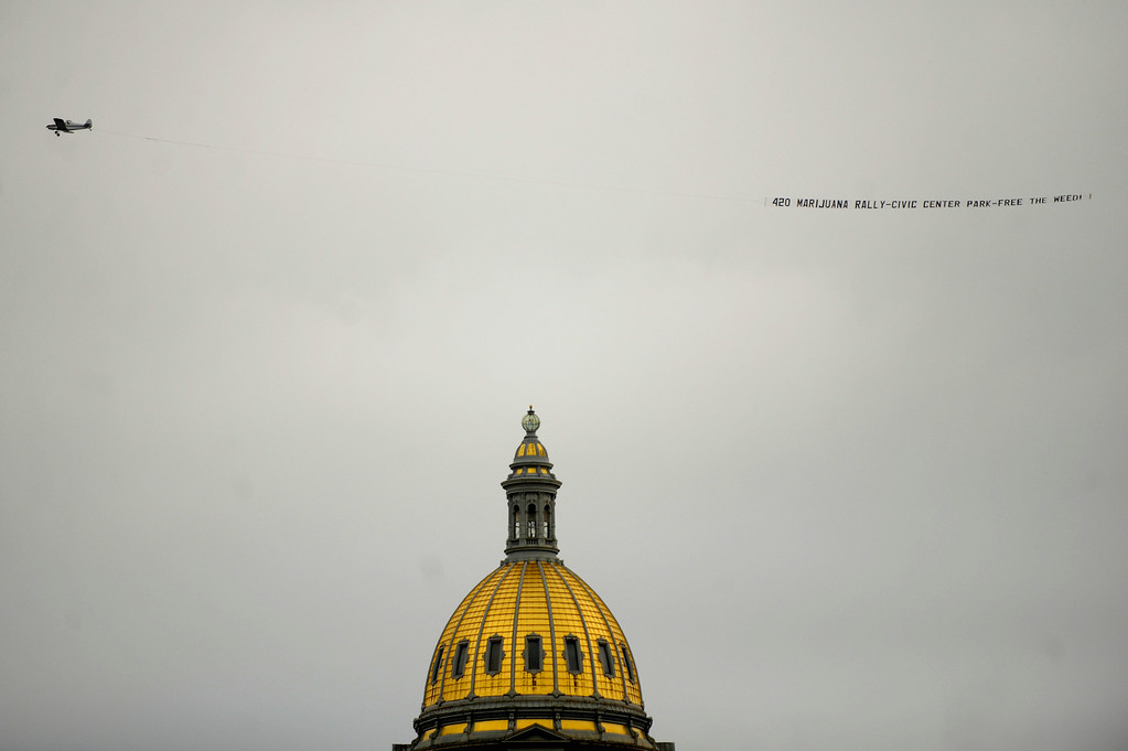 ". An aircraft circles the capitol with a sign that says ""420 marijuana rally - Civic Center Park - Free The Weed!\"" during the Annual Denver 420 Rally in Civic Center Park.      Joe Amon, The Denver Post"