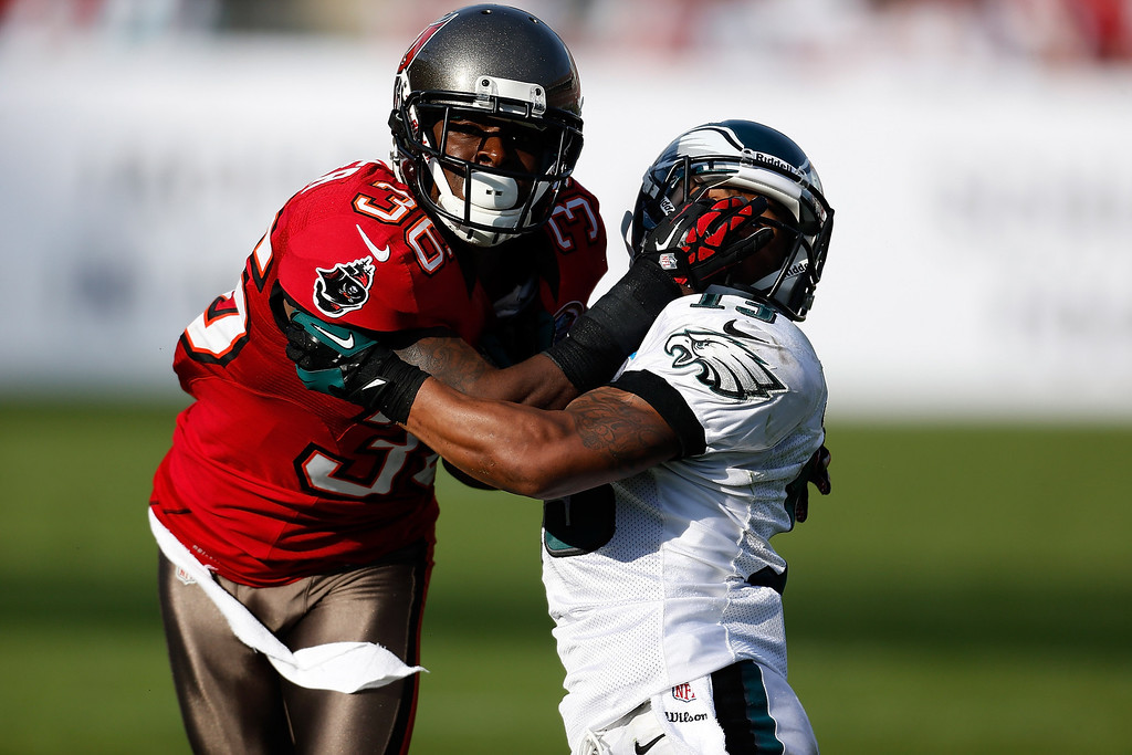 . TAMPA, FL - DECEMBER 09:  Defender Danny Gorrer #6 of the Tampa Bay Buccaneers fights for postion with receiver Damaris Johnson #13 of the Philadelphia Eagles during the game at Raymond James Stadium on December 9, 2012 in Tampa, Florida.  (Photo by J. Meric/Getty Images)