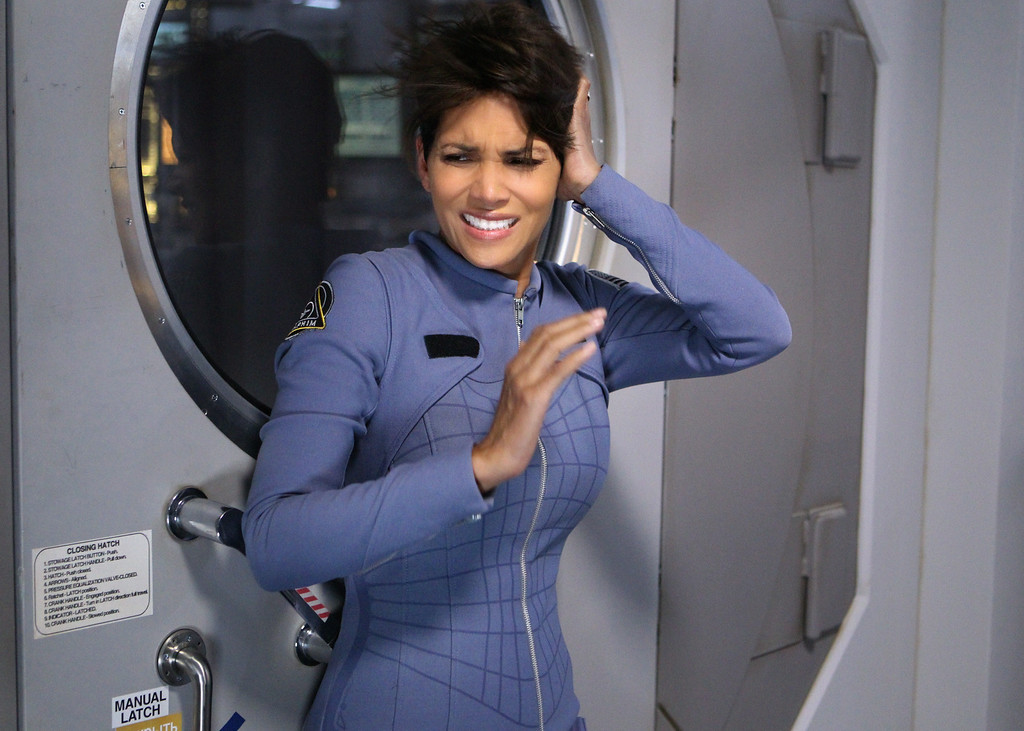 """. \""""More in Heaven and Earth\"""" -- EXTANT: CBS\'s new summer series EXTANT is a mystery thriller starring Academy Award-winner Halle Berry as Molly Woods, a female astronaut trying to reconnect with her family after returning from a year in outer space. Her mystifying experiences in space lead to events that will ultimately change the course of human history. EXTANT premieres Wednesday, July 9 (9:00-10:00 PM, ET/PT).  Photo: Sonja Flemming/CBS ©2014 CBS Broadcasting, Inc. All Rights Reserved"""