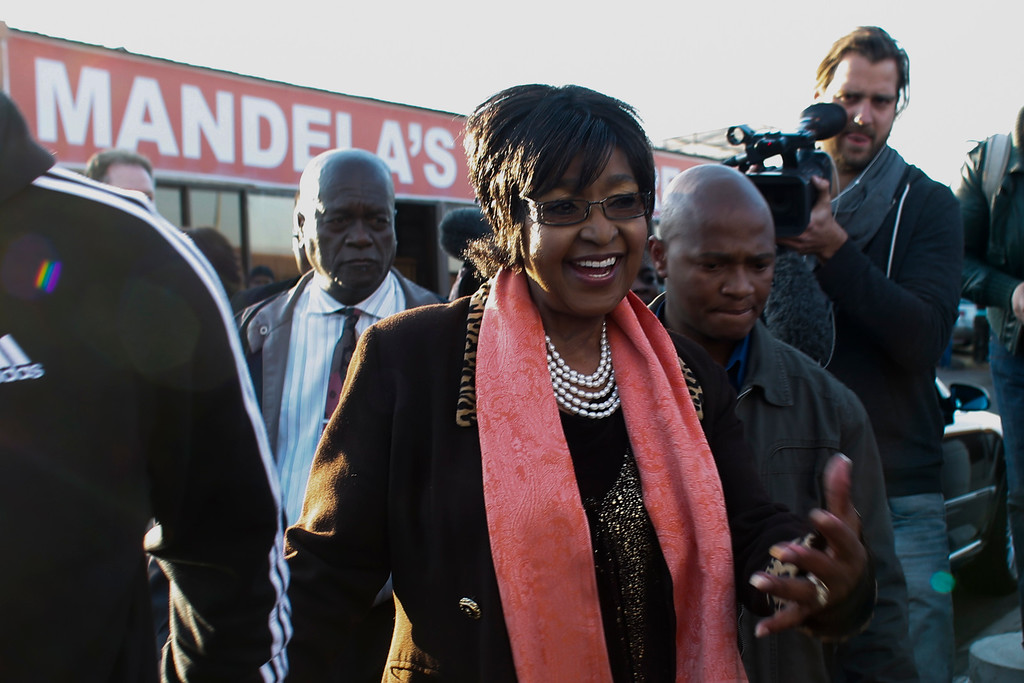 . Winnie Madikizela-Mandela arrives for a press statement in front of the house of her former husband and former South African President Nelson Mandela in Soweto, Friday, June 28, 2013. Members of Nelson Mandela\'s family as well as South African Cabinet ministers have visited the hospital where the 94-year-old former president is critically ill. (AP Photo/Markus Schreiber)