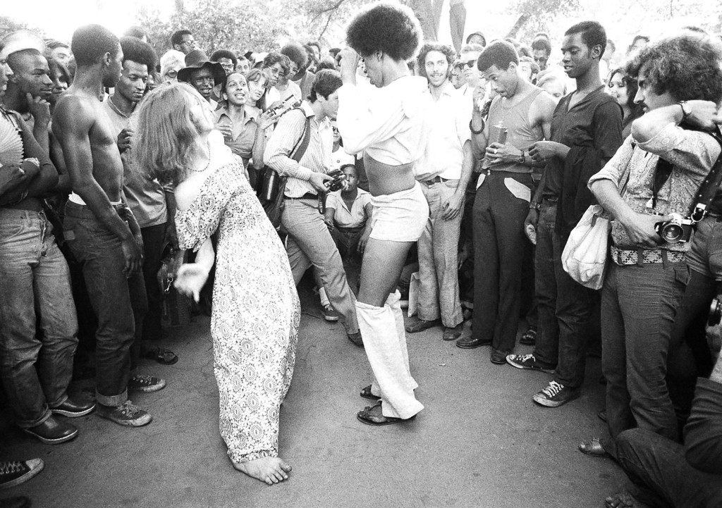 . Two young men, one wearing a dress, dance in New York\'s Central Park, June 27, 1971, in front of a group of gays and sympathizers. A march up Sixth Avenue and rally in the park highlighted Gay Pride week. About 5,000 people attended the rally in the park. (AP Photo/Ron Frehm)