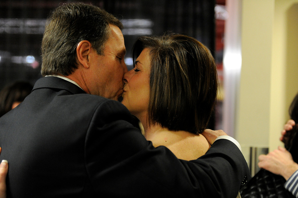 . DENVER, CO. - APRIL 2: Former DU hockey coach George Gwozdecky gives a kiss to his wife Bonnie after a news conference April 2, 2013 at Magnuss Arena. Gwozdecky was on hand to discuss the school firing him on Monday. This ends his Pioneers coaching tenure at 19 seasons. (Photo By John Leyba/The Denver Post)