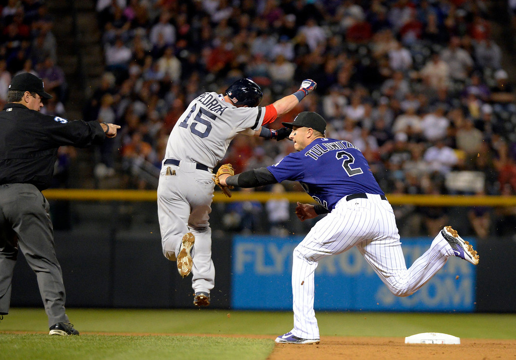 . DENVER, CO. - SEPTEMBER 24: Troy Tulowitzki (2) of the Colorado Rockies tags out Dustin Pedroia (15) of the Boston Red Sox at second during the 4th inning September 24, 2013 at Coors Field. (Photo by John Leyba/The Denver Post)