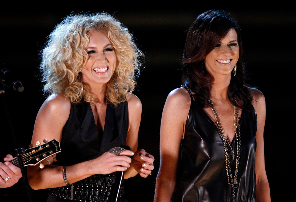 . Little Big Town , from left, Kimberly Schlapman, and Karen Fairchild perform at the 47th annual CMA Awards at Bridgestone Arena on Wednesday, Nov. 6, 2013, in Nashville, Tenn. (Photo by Wade Payne/Invision/AP)