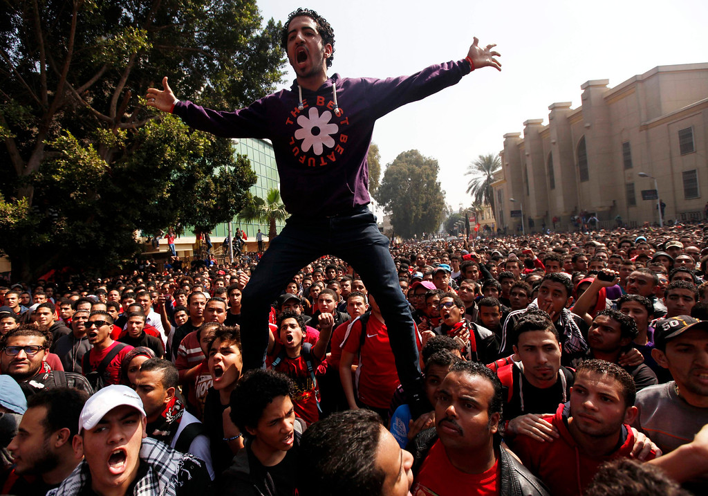". Al-Ahly fans, also known as ""Ultras\"", celebrate and shout slogans in front of the Al Ahly club after hearing the final verdict of the 2012 Port Said massacre in Cairo March 9, 2013. REUTERS/Amr Abdallah Dalsh"