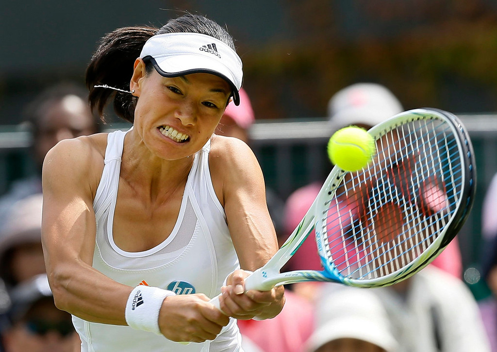 . Kimiko Date-Krumm of Japan plays a shot to Carina Witthoeft of Germany during their Women\'s first round singles match at the All England Lawn Tennis Championships in Wimbledon, London, Tuesday, June 25, 2013.  (AP Photo/Kirsty Wigglesworth)