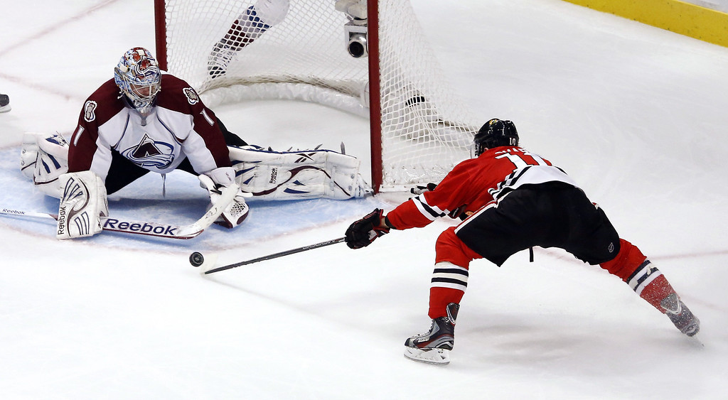 . Chicago Blackhawks center Patrick Sharp, right, is unable to get the rebound off a shot on Colorado Avalanche goalie Semyon Varlamov (1), of Russia, during the second period of an NHL hockey game, Wednesday, March 6, 2013, in Chicago. (AP Photo/Charles Rex Arbogast)