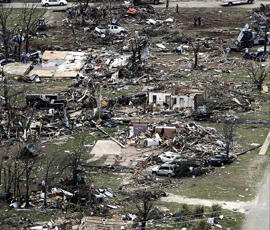 . Homes are heavily damaged in this aerial view of Granbury, Texas on Thursday, May 16, 2013, after multiple tornados hit the area Wednesday night. Ten tornadoes touched down in several small communities in North Texas overnight, leaving at least six people dead, dozens injured and hundreds homeless. Emergency responders were still searching for missing people Thursday afternoon.  (AP Photo/Star-Telegram/Ron T. Ennis)