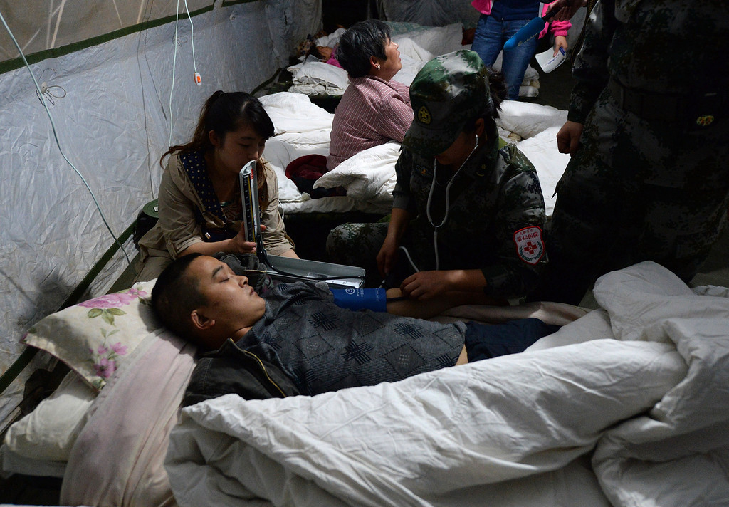 . An injured man is treated at the Lushan People\'s hospital after a magnitude 7.0 earthquake hit the city of Ya\'an, in southwest China\'s Sichuan province on April 20, 2013. More than 150 people were killed and 5,700 injured when a strong earthquake hit a mountainous part of southwestern China on April 20, destroying thousands of homes and triggering landslides in an area devastated by a major tremor in 2008. MARK RALSTON/AFP/Getty Images