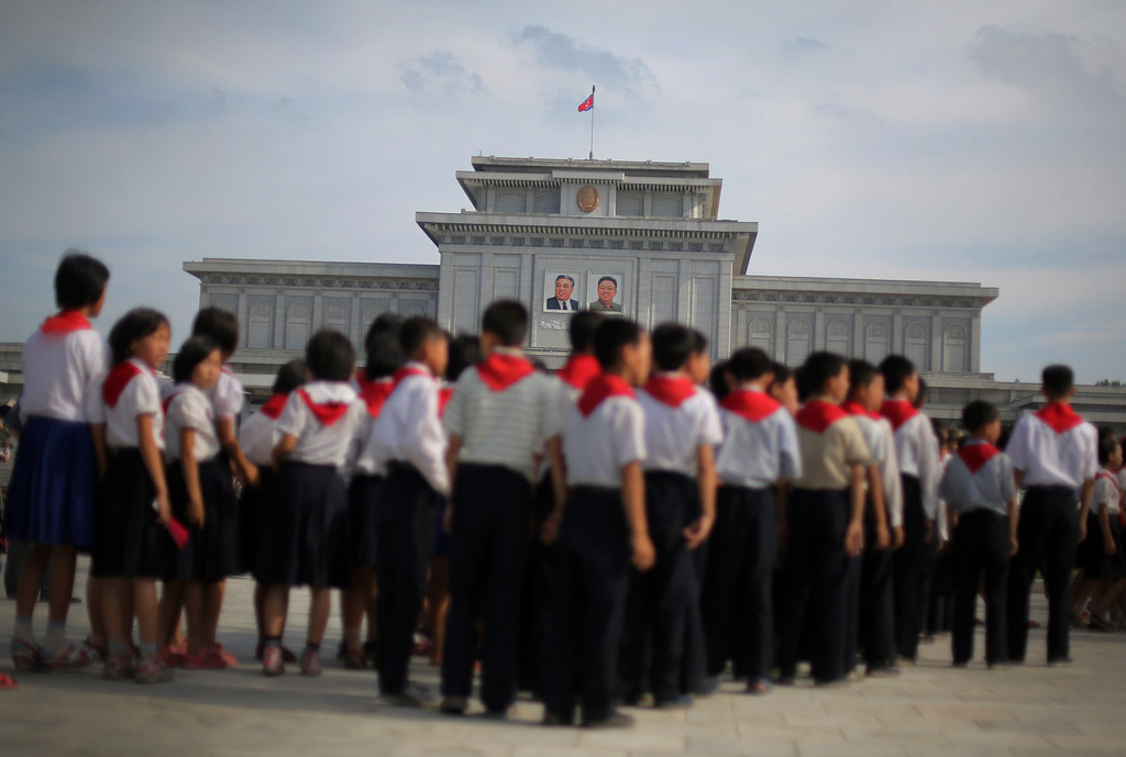 . North Korean schoolchildren tour the park surrounding Kumsusan Palace of the Sun, the mausoleum where bodies of the late leaders Kim Il Sung and Kim Jong Il lie embalmed on Thursday, July 25, 2013 in Pyongyang, North Korea. (AP Photo/Wong Maye-E)