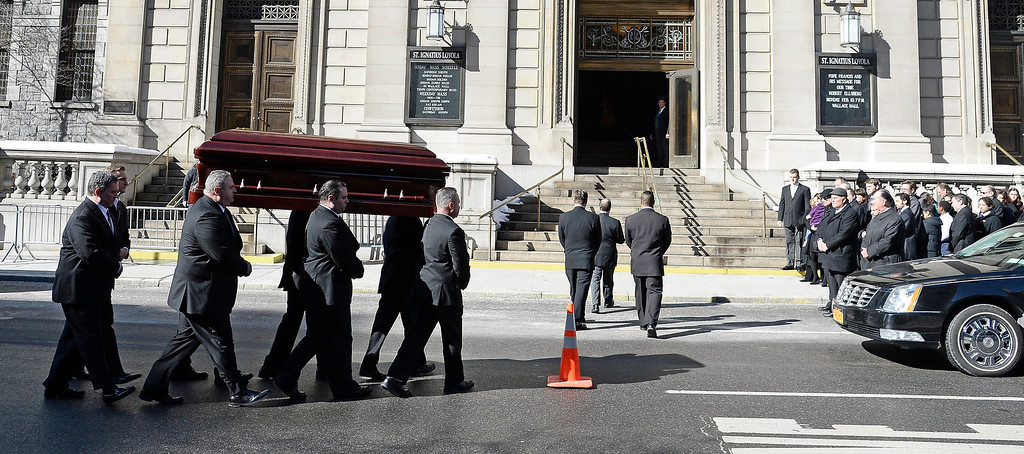 . Pall-bearers carry the casket of US Actor Phillip Seymour Hoffman into the Funeral Mass at St Ignatius Church in New York, New York, USA 07 February 2014. Hoffman, 46, died 02 February from a suspected drug overdose.  EPA/ANDREW GOMBERT