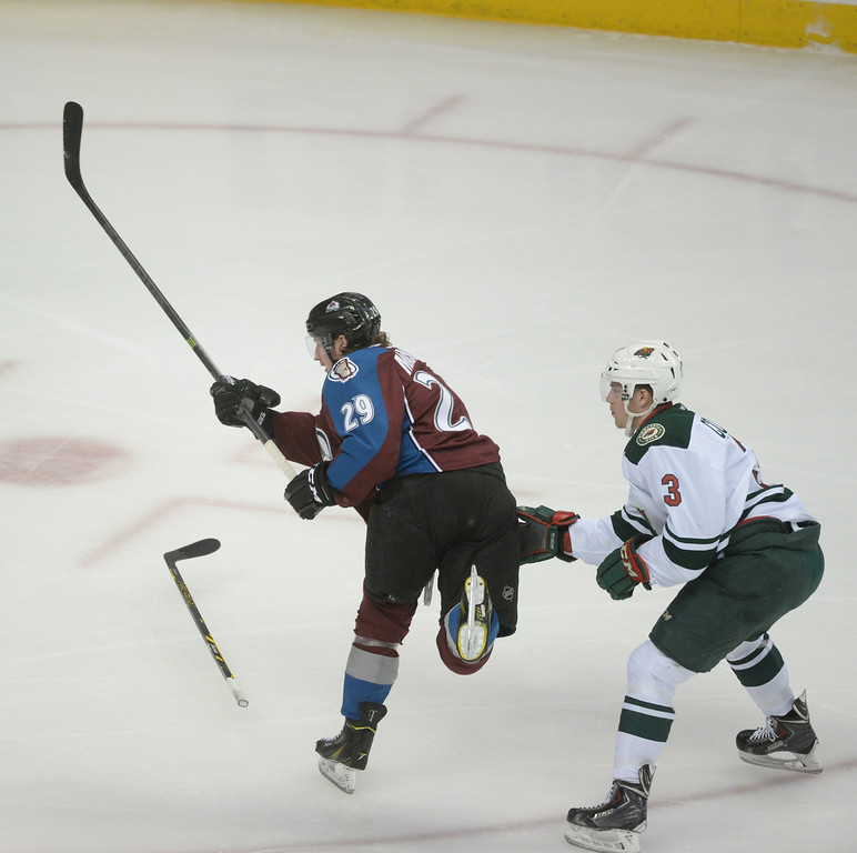 . Nathan MacKinnon (29) of the Colorado Avalanche scores the first Avalanche goal of the game ahead of Charlie Coyle (3) of the Minnesota Wild during the first period of action. The Colorado Avalanche hosted the Minnesota Wild in the first round of the Stanley Cup Playoffs at the Pepsi Center in Denver, Colorado on Saturday, April 19, 2014. (Photo by Karl Gehring/The Denver Post)