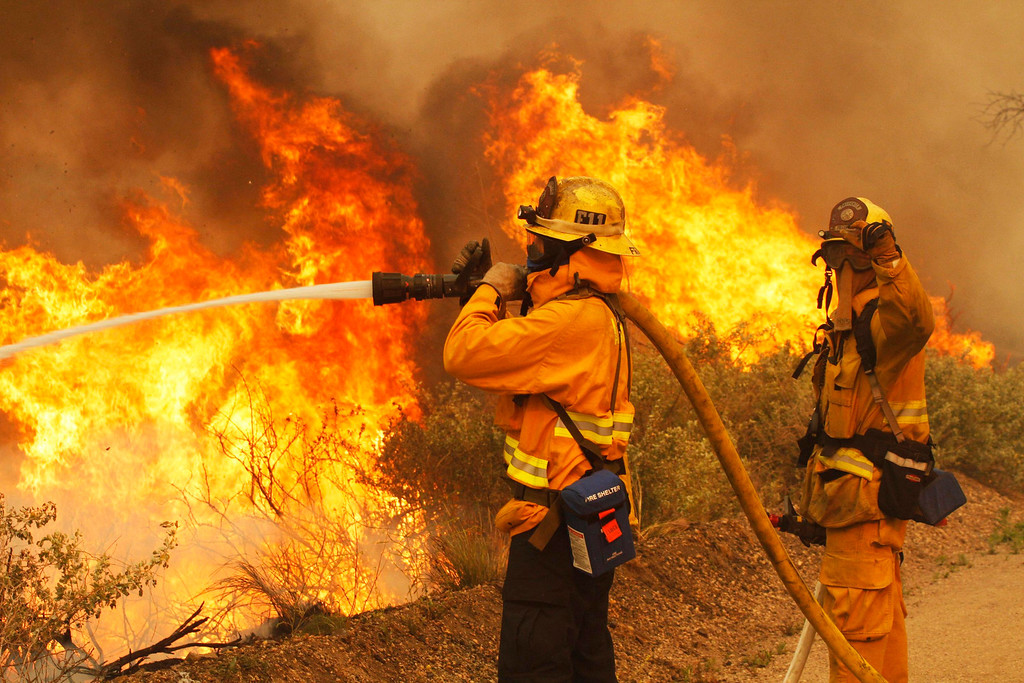 . Firefighters battle the Springs Fire at Point Mugu State Park May 3, 2013. REUTERS/Jonathan Alcorn