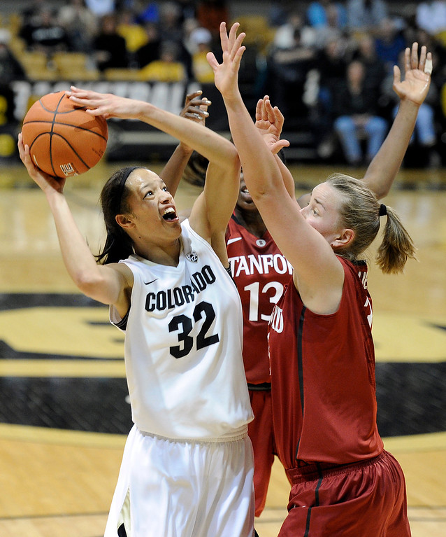 . University of Colorado\'s Arielle Roberson takes a shot over Mikaela Ruef, right, during a game against Stanford on Friday, Jan. 4, at the Coors Event Center on the CU campus in Boulder.    Jeremy Papasso/Camera