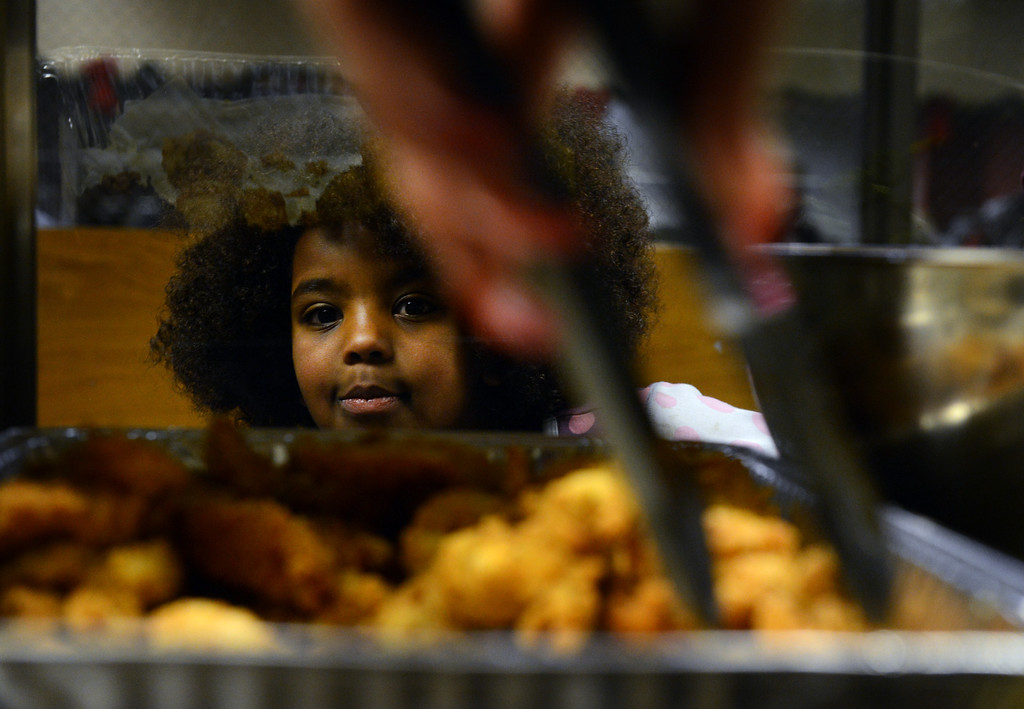 . Chaya Kidane, 6, watches her meal being served during a Kwanzaa Celebration at the Zion Senior Center in Denver, CO, Saturday December, 29, 2012. The event highlighted the 150th anniversary of the Emancipation Proclamation with a theatrical performance depicting an enslaved family on Watch Night or Freedom\'s Eve, December 31, 1862. During the performance the family read the proclamation in anticipation of their coming freedom on New Years day, 1863. Craig F. Walker, The Denver Post