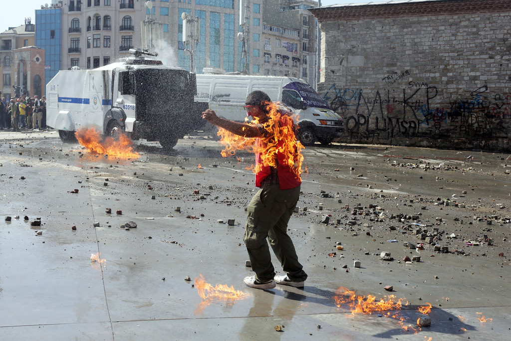 . A demonstrator\'s clothes are set on fire during clashes with riot police in Taksim square on June 11, 2013.    AFP PHOTO / OREN ZIV/AFP/Getty Images