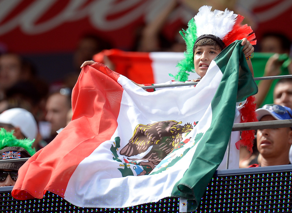 . Mexico fans cheer on their team during their game against Martinique in the CONCACAF Gold Cup soccer game July 14, 2013 at Sports Authority Field at Mile High. (Photo By John Leyba/The Denver Post)