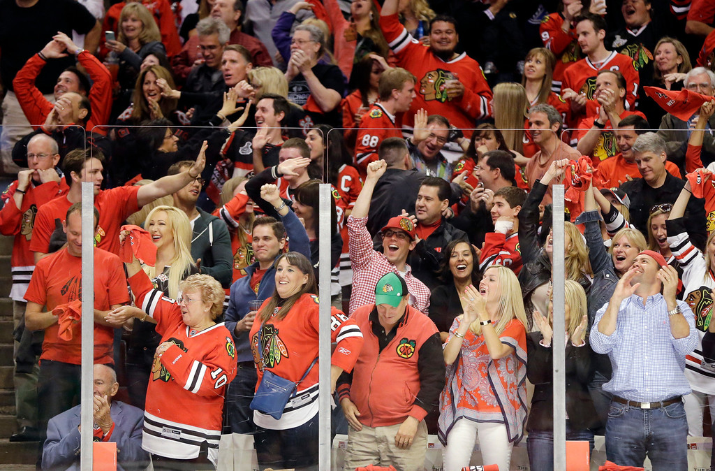 . Chicago Blackhawks fans cheer after right wing Patrick Kane (88) scored during the first period in Game 5 of the NHL hockey Stanley Cup playoffs Western Conference finals against the Los Angeles Kings, Saturday, June 8, 2013, in Chicago. (AP Photo/Nam Y. Huh)