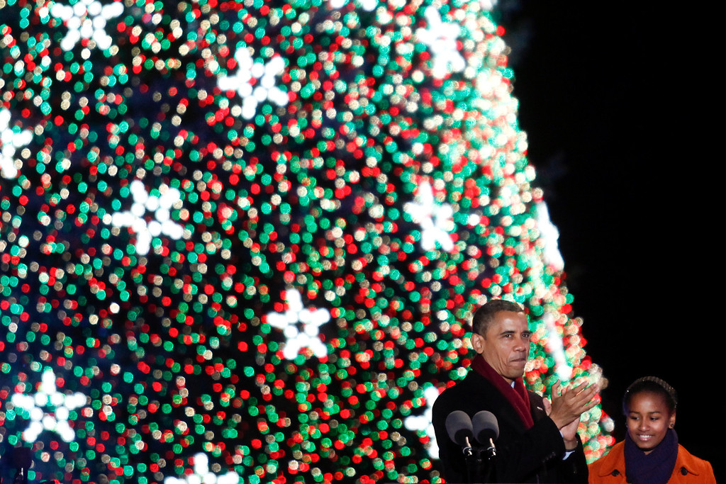 . President Barack Obama and his daughter, Sasha, attend the National Christmas Tree Lighting on the Ellipse in Washington, Dec. 6, 2012. (Luke Sharrett for The New York Times)